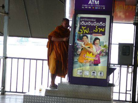 Monks can multitask - texting & using the ATM