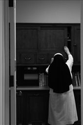Sister Theresa reaching for a cookbook to make dinner. : by hannahjane, Views[127]