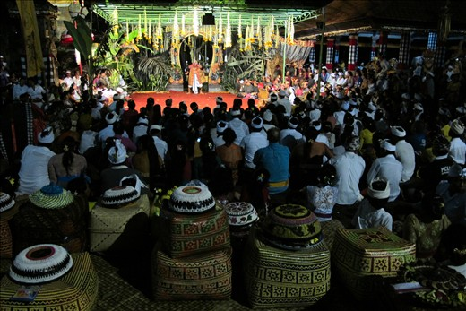 Keben, traditional Balinese crafted box filled with elements to be presented to God are put together at the back of audience who gathered and continuously watching a historical - mystical drama shown at midnight until early morning. Not only as a ceremony but people sincerely come to celebrate it. More people come as the night gets late although they have to sit on the ground.