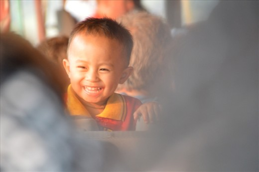 The journey down the Mekong River can be dull, sad and poor, So when i saw this sweet boy laughing with tourists, I couldn't resist taking this picture- the feeling I had when capturing this moment is portrayed beautifully in this image with the sun shining through. Bright, happy and full of hope.