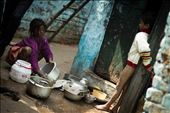 A boy looking at her sister washing utensils in a slum area: by hashimhakeem, Views[185]