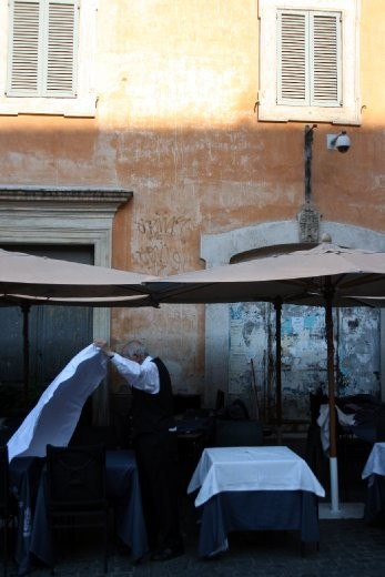 Setting up for breakfast. Early morning in Rome.