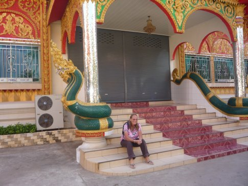 A rest from the hot sun on the steps of a small temple