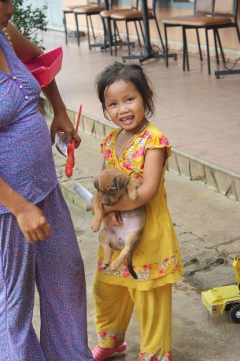 This sweet little girl was very proud of her puppy. I loved how she was smiling at me...a complete stranger.