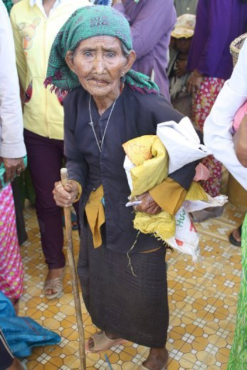 This elderly lady is from the Hmong Tribe, which is an outcast group of Vietnamese society. She was waiting patiently to receive her portion of rice.