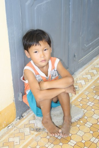 This little guy was on the outside looking in. He stayed out of the crowd that was giving out rice...I wondered what was going on inside his head that morning.