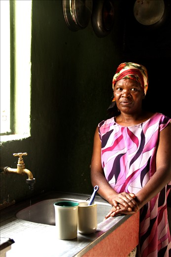 A proud mama in her mean kitchen in the Coloured Township of Nieu-Bethesda