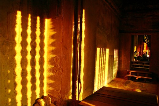 Sunset reflection on the wall inside one of the temples at Angkor, Siem Reap