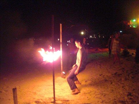 Steven doing flaming limbo