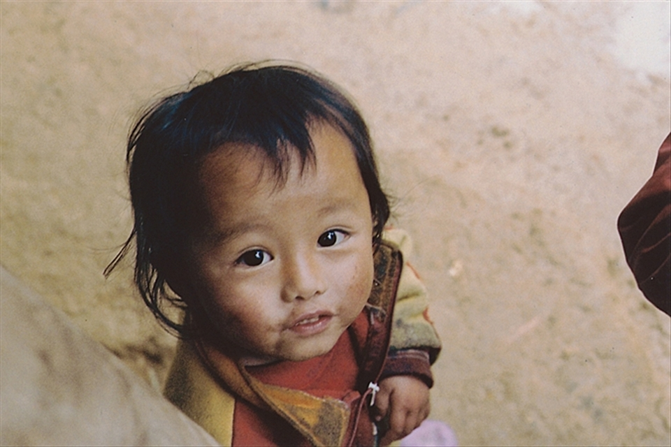 Nearing the Black Hmong village, we encountered some muddy, but friendly little faces.