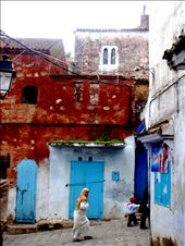 Hurried steps: A woman hurries through the unusually cold streets of Chefchauen Morocco : by hillaryclausen, Views[204]