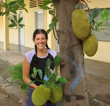 Laurina hiding her biggest attributes being a jackfruit trees biggest attributes.