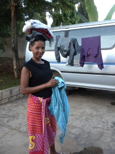 Hdije folding my clothes, African style