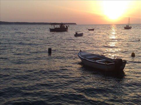 sunset of ahmoody harbor, santorini