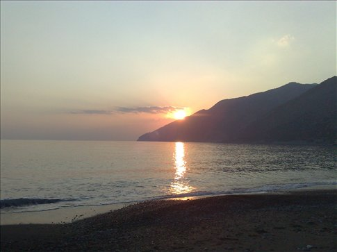 view of sunset from our campsite at pavlos beach, crete-only four other tents!