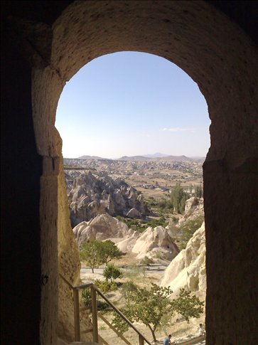 View out the door of a rock cathderal at the Goreme outdoor museum