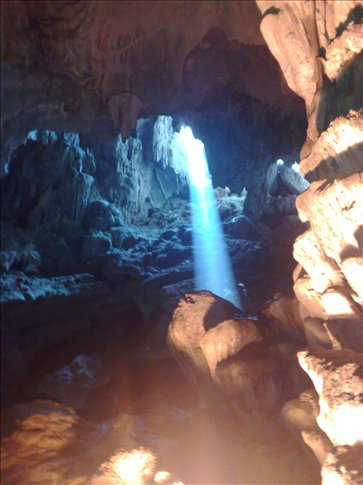 light shining through the top of the cave