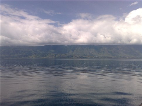 view from the ferry on the way to Tuk-tuk, Danau Toba