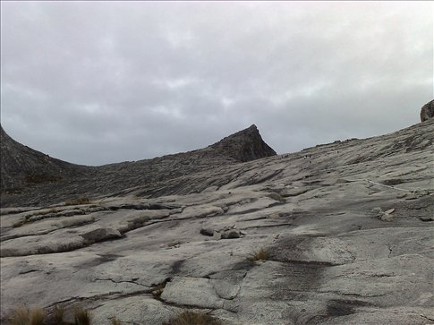 view of the summit(the pointy rock) from the descent