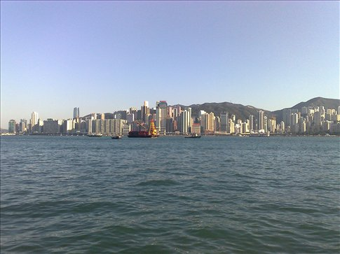 riding the ferry across the Hong Kong  harbor