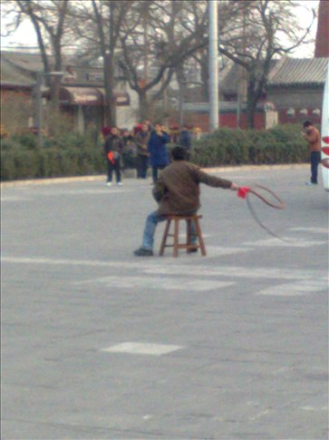 random guy cracking a whip in a square-he was pretty good.