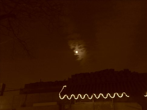 full moon through sepia