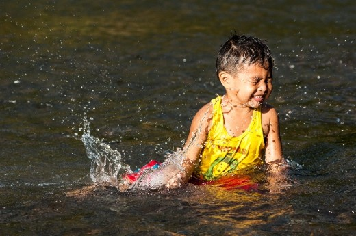 A boy playing a splash of water