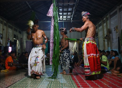 Three Balians from Muara Mea village dance while reciting spells to cure diseases. They could perform healing procession even up to 18 hours without stopping. They use natural materials taken from Gunung Lumut to heal diseases and for ceremonies.