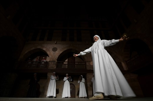 A Tanora dancer performs a SUFI dance during the Cairo festival  for religious SUFI music.this festival is held once a year inside the Obet El Ghoury ancient theater which was built 1300 years ago.
