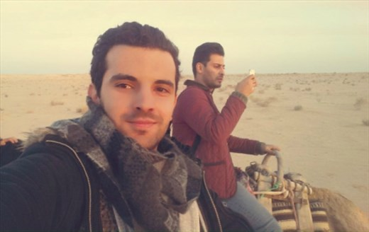 Musaab and I riding camels