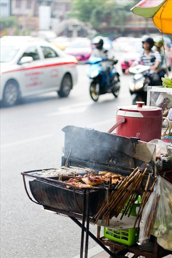 Great variety and amount of street food in Bangkok forces street vendors to locate even on the busy carriageways such as Wongwian Yai Circle in Bangkok, Thailand.