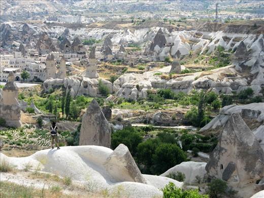 A wandering traveler surveys the fairytale landscape of Cappadocia, Turkey.