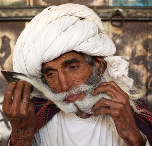For Rabari men the moustache is a very important asset and it gives them a high status