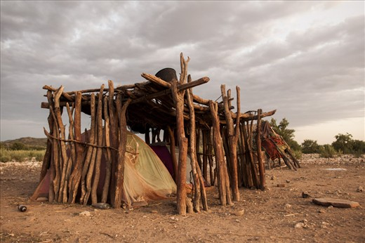 Lured by modern amenities, Himbas are struggling to keep their traditions. Many don't build huts anymore, using tents bought in town, lightly shaded with twigs.
