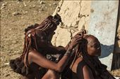 Even in mourning, Himba women pay attention to their appearance. Nowadays they use ready-made extensions clipped with clay, instead of hair collected from the men, as they used to do in the past. : by intotheworld, Views[594]