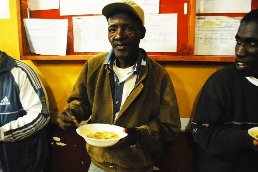 the towns gardener, an elderly man, he does not speak, but he shares soup with the others in the church