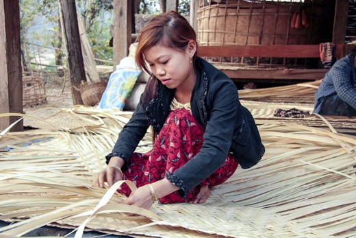 "After preparing the campfire breakfast for the family, Hayma, the wife of Manue (her name means ""forest"" in Burmese) spends her morning hours cutting and laminating bamboo stalks into sheets and planks that serve as new walls for their small hut. Every year by the end of the monsoon rains, the bamboo planks have to be replaced and renewed to offer proper shelter for the family. Hamya explains that weaving bamboo is one of the ancestors' techniques in the Shan Region: not only it shelters and protects us during the cold nights, but it also allows for the passage of the river breeze during the hot days."