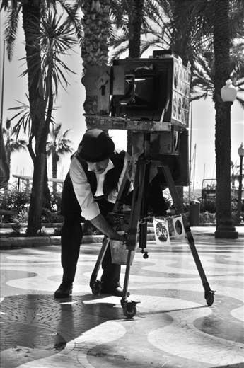 CAPTURING MEMORIES OF LIFE THROUGH OLD TECHNIQUES .... this lovely man was on the sidewalk taking and selling photos of people with this amazing traditional and still working camera