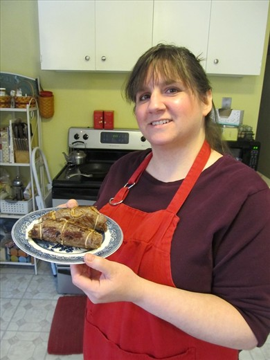 Me holding the browned braciole.