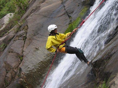 Miral waterfall repelling near Baños, Ecuador