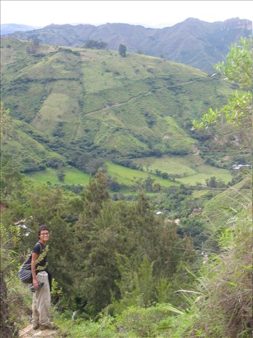 Miral takes in the view on bike-ride-turned-hike near Vilcabamba, Ecuador