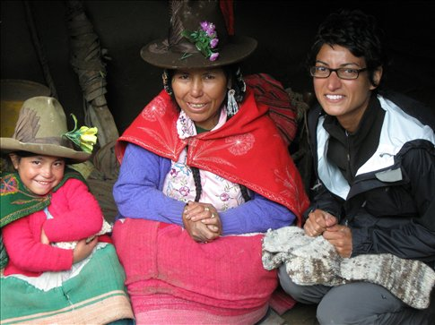 Miral buys some hand-made socks from new friends in Vicos, Peru