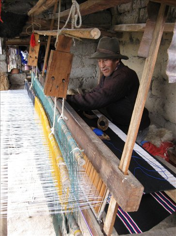 A Vicos neighbor showing us how he makes traditional ponchos on his loom