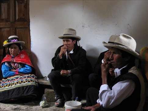 Our Vicos friends hitting hard their bags of Coca leaf