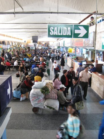 Arequipa bus terminal, typical in S America, with food vendors lining the left and ticket vendors on the right
