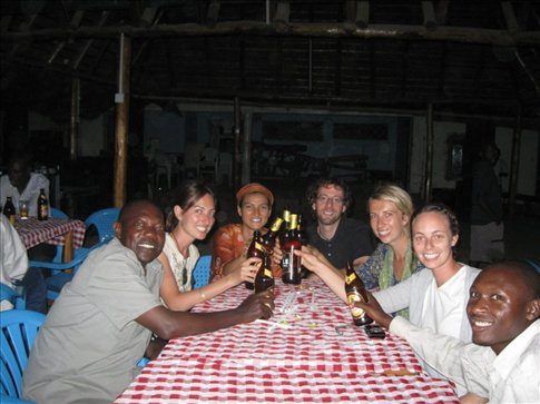 Us, our 3 co-volunteers, & Director Dominic (left) at the Uganda-Tanzania border