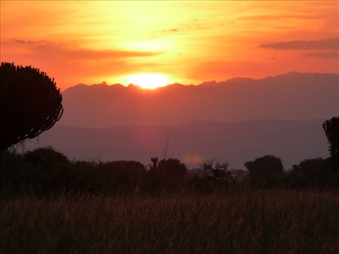 The sun sets over the Rwenzori Mountains that separate Uganda and DRCongo