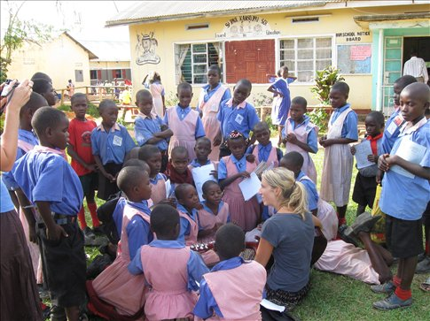 Our co-volunteer, Emma, entertains some of the beautiful children a KAASO School