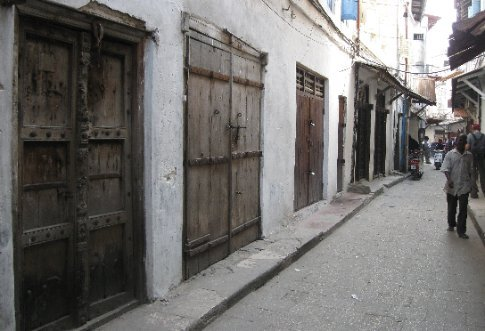 Street scene in Stone Town, Zanzibar, where one door is more beautiful than the last.