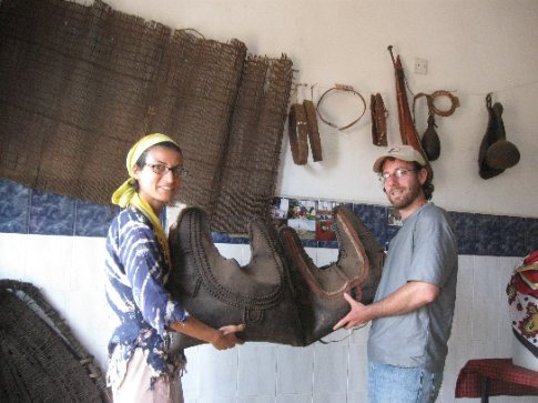 Mi and Ive hold bags for donkey transport at the Maasai museum being developed by our new friends to preserve their history.